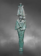 Ancient Egyptian bronze statue of Osiris, Ptolomaic Period, (722-30 BC). Egyptian Museum, Turin. Grey background. Old fundCat 39. .<br /> <br /> If you prefer to buy from our ALAMY PHOTO LIBRARY  Collection visit : https://www.alamy.com/portfolio/paul-williams-funkystock/ancient-egyptian-art-artefacts.html  . Type -   Turin   - into the LOWER SEARCH WITHIN GALLERY box. Refine search by adding background colour, subject etc<br /> <br /> Visit our ANCIENT WORLD PHOTO COLLECTIONS for more photos to download or buy as wall art prints https://funkystock.photoshelter.com/gallery-collection/Ancient-World-Art-Antiquities-Historic-Sites-Pictures-Images-of/C00006u26yqSkDOM
