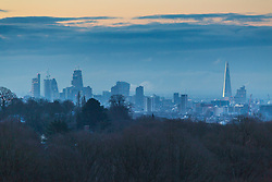 """Steam rises from skyscrapers in The City, seen from Hampstead Heath. The threatened snow from """"The Beast From The East"""" weather system doesn't materialise overnight in London leaving a crisp, clear morning in North London. London, February 27 2018."""