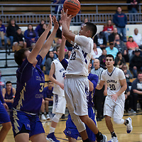 Miyamura's Gabe Lee Jr. (10) takes a shot inside the paint  against Kirtland Central Thursday night in Gallup.