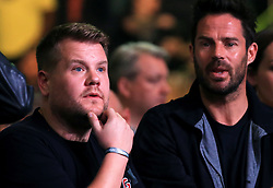 James Corden (left) and Jamie Redknapp watches the Anthony Joshua v Andy Ruiz Jr fight at Madison Square Garden, New York.