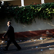 A man passes by the outside wall of a polling station at Masr El Gdeeda district in Cairo.