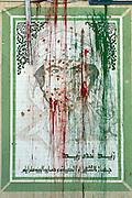 Sco0033837 .  Daily Telegraph..A defaced Portrait of Muammar Gadaffi in central Tripoli...Tripoli 9 September 2011