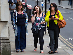 Roz Wickens, left, mother of Charlotte Brown leaves the Old Bailey with her daughter Katie and a family member after watching the trial of Jack Shepherd from Abergavenny, Wales, who is absent from his trial on charges of manslaughter following the death of Charlotte 'Charli' Brown, 24, who died following the capsizing of Shepherd's speedboat during a late night cruise on the River Thames in 2015. London, July 04 2018.