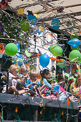 Children ride on a float at the Nottingham City Carnival; 2007,