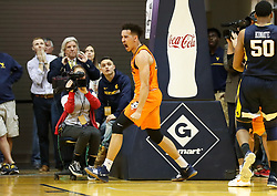 Feb 10, 2018; Morgantown, WV, USA; Oklahoma State Cowboys guard Jeffrey Carroll (30) celebrates late in the game against the Oklahoma State Cowboys at WVU Coliseum. Mandatory Credit: Ben Queen-USA TODAY Sports