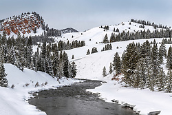 Battle Mountain towers above the Hoback River on a winter day in Bondurant Wyoming.