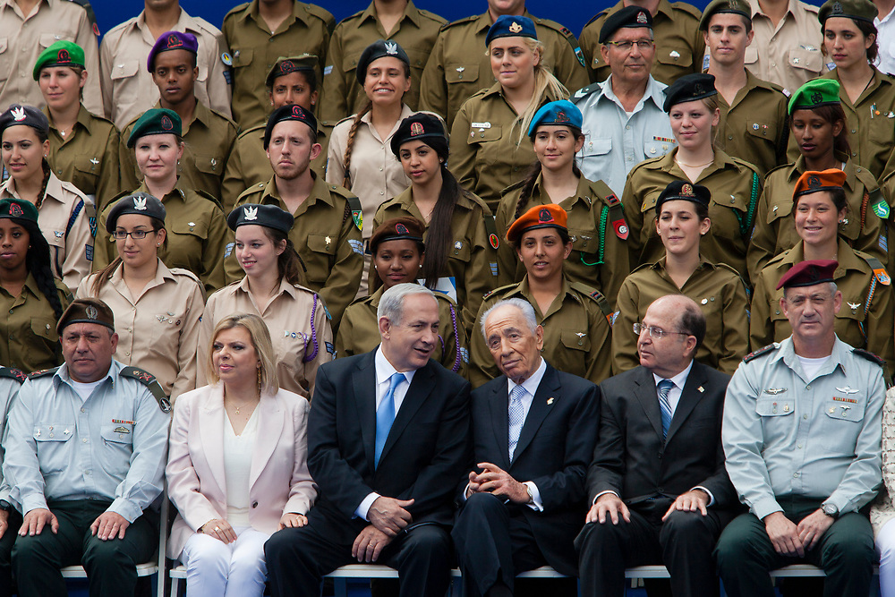 Israel's President Shimon Peres (3rd R) Israel's Prime minister Benjamin Netanyahu (3rd L), his wife Sara Netanyahu (2nd L), Israel's Defense Minister Moshe Yaalon (2nd R), Israeli Chief of Staff, Lieutenant-General Benny Gantz (R) Deputy Israeli Chief of Staff, Major General Gadi Eizenkot (L) and selected outstanding Israeli soldiers and officers stand attend Israel's Independence Day celebration at the Israeli President's Residence in Jerusalem, on April 16, 2013, as the Jewish state celebrates its 65th Independence Day.