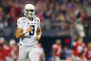 Marcus Mariota #8 of the Oregon Ducks jogs off the field at halftime against the Ohio State Buckeyes during the College Football Playoff National Championship Game at AT&T Stadium on January 12, 2015 in Arlington, Texas.  (Cooper Neill for The New York Times)