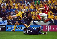 BESSA PORTO  PORTUGAL 22/06/04  DENMARK V SWEDEN EURO 2004<br /> FREDIK LJUNGBERG (SWEDEN) RUNS INTO DANISH 'KEEPER THOMAS SORENSEN AS RENE HERIKSEN LEAPS OVER HIM<br /> Photo Roger Parker Digitalsport
