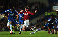 Photo: Tony Oudot.<br /> Chelsea v Manchester United. The Barclays Premiership. 09/05/2007.<br /> Ole Gunnar Solskjaer of Man Utd is tackled by Mikel and Paulo Ferreira of Chelsea