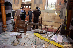 December 11, 2016 - Cairo, Cairo, Egypt - Egyptian security officials and investigators inspect the scene following a bombing inside the Saint Peter and Saint Paul Coptic Orthodox Church in Cairo's Abbasiya neighbourhood on December 11, 2016, . The blast killed at least 25 worshippers during Sunday mass inside the Cairo church near the seat of the Coptic pope who heads Egypt's Christian minority, state media said  (Credit Image: © Amr Sayed/APA Images via ZUMA Wire)