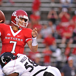 Sep 7, 2009; Piscataway, NJ, USA;  Rutgers quarterback Tom Savage (7) is hit in the end zone by Cincinnati defensive tackle Brandon Mills (58) during the second half as Cincinnati defeats Rutgers 47-15 in NCAA Big East football at Rutgers Stadium.