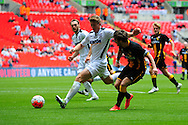 Jimmy Oates of Hereford FC puts in a tackle on Sean Taylor of Morpeth Town AFC during the FA Vase match between Hereford FC and Morpeth Town at Wembley Stadium, London, England on 22 May 2016. Photo by Mike Sheridan.