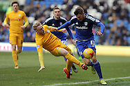 Preston North End captain Tom Clarke tackles Cardiff City's Anthony Pilkington (13). Skybet football league championship match, Cardiff city v Preston NE at the Cardiff city stadium in Cardiff, South Wales on Saturday 27th Feb 2016.<br /> pic by Carl Robertson, Andrew Orchard sports photography.