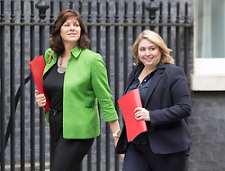 © Licensed to London News Pictures. 18/06/2018. London, UK. Energy Minister Claire Perry (L) and Northern Ireland Secretary Karen Bradley arrive for an emergency cabinet meeting in Downing Street. Mrs May announced further spending on the National Health Service  saying 'NHS in England is to get an extra £20bn a year by 2023 as a 70th birthday present'.  Photo credit: Peter Macdiarmid/LNP