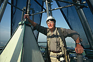 Dennis Brack with hand on the top of the Washington Monument.  in  August 1999<br />Photo by Dennis Brack. bb77
