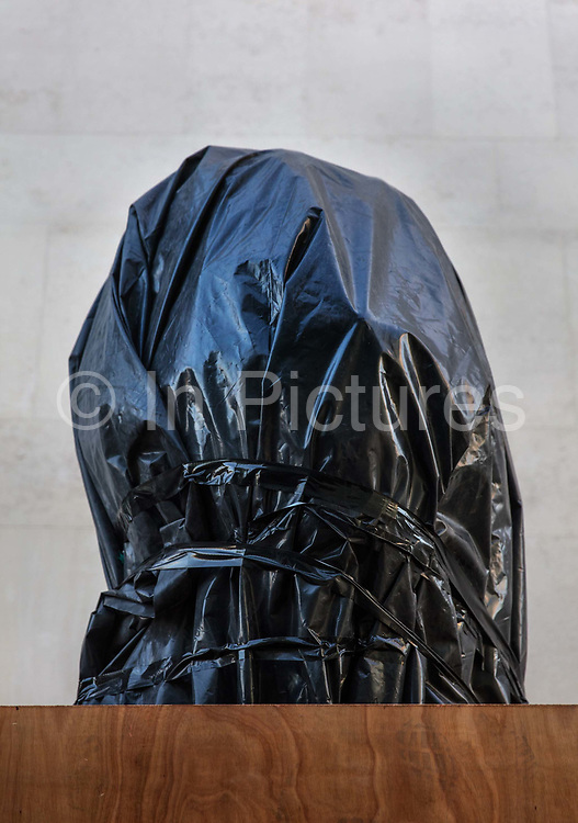 Hidden beneath the cover is a bronze sculpture of former President of South Africa and anti-apartheid activist Nelson Mandela on 15th June 2020 in Londons South Bank, United Kingdom. The statue, created by English sculptor Ian Walters, is 9 feet high, and made in bronze. The statue was wrapped and boarded up to protect it from attacks by far-right extremists.