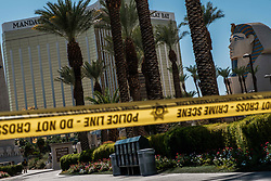 October 3, 2017 - Las Vegas, Nevada, U.S - Yellow police tape and an FBI agent can be seen on Las Vegas Boulevard near the Mandalay Hotel and the site of Sunday's mass shooting which claimed the lives of 59 people and injured hundreds of others. (Credit Image: © Nick Otto via ZUMA Wire)