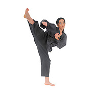 Female Martial Arts practicing in a studio on white background