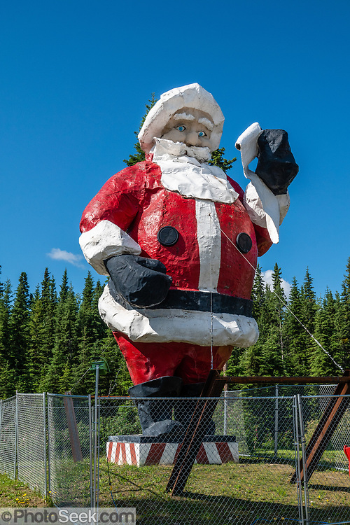 North Pole, in the Fairbanks North Star Borough, Alaska, USA. Despite its name, the city of North Pole is 1700 miles (2700 km) south of Earth's geographic North Pole. North Pole's biggest attraction is a gift shop named Santa Claus House (evolved from an earlier trading post), flanked by the world's largest fiberglass statue of Santa Claus. A small group of domesticated Reindeer are kept nearby. The town advertises its ZIP code 99705 as belonging to Santa. The legend of Santa Claus (aka Saint Nicholas, Kris Kringle, or Father Christmas) evolved in Western Christian culture from the historical Saint Nicholas, a fourth-century Greek bishop and gift-giver of Myra (now Demre, in the Republic of Turkey).