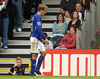 Photo: Daniel Hambury.<br /> Fulham v Everton. The Barclays Premiership.<br /> 27/08/2005.<br /> A young ball boy waves goodbye to Everton's Phil Neville after he was sent off.