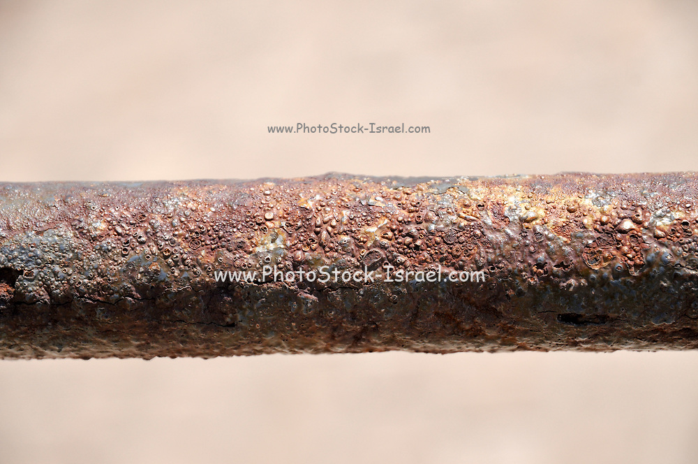 Old rusty horizontal water pipe