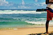 Mauritius Island. Gris Gris Beach at Souillac. Boy enter at the sea