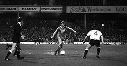Steve McMahon (l), Liverpool, goes forward with the ball