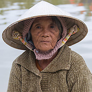 Vietnam, Hoi An, portrait of a woman wering a pointed hat.