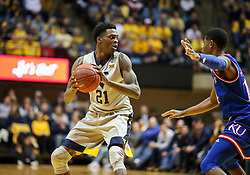 Jan 15, 2018; Morgantown, WV, USA; West Virginia Mountaineers forward Wesley Harris (21) attempts to pass the ball during the second half against the Kansas Jayhawks at WVU Coliseum. Mandatory Credit: Ben Queen-USA TODAY Sports