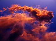 Sunset light illuminating cumulus clouds east of the Wassuk Range and above Walker Lake, Nevada.