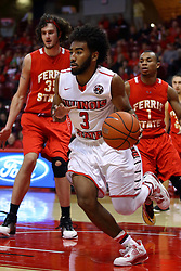 26 November 2016:  Keyshawn Evans(3) drives through the lane when double teamed by Zach Hankins and Quentin Ruff  during an NCAA  mens basketball game between the Ferris State Bulldogs the Illinois State Redbirds in a non-conference game at Redbird Arena, Normal IL