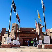 122713  Adron Gardner/Independent<br /> <br /> Protest signs are affixed to the flag poles outside the Navajo Nation Tribal Council Chambers in Window Rock Friday.