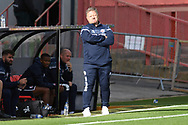 Crawley Town Head Coach John Yems grimaces during the EFL Sky Bet League 2 match between Cheltenham Town and Crawley Town at Jonny Rocks Stadium, Cheltenham, England on 10 October 2020.
