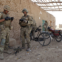 British soldiers of 16 Air Assault Bde's elite BRF (Brigade Reconnaissance Force) check their equipment as they move from compound to compound searching for weapons and explosives as part of an operation in Helmand Province, Southern Afghanistan on the 15th of March 2011.