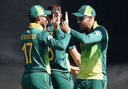 Cape Town-181006-South African captain Faf du Plessie and Reeza Hendricks celebrates Dale Steyn's second weeket against  Zimbabwean,as he bowled out Sean Williams  in the 3rd ODI match at Boland Park cricket stadium. .Photographer:Phando Jikelo/African News Agency(ANA)