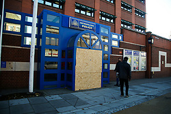© Licensed to London News Pictures. 12/11/2020. London, UK. A man looks at the entrance to Edmonton Police Station in north London which is boarded following an incident where a vehicle was driven into the police station just before 7pm on Wednesday, 11 November. A 45-year-old man left the vehicle before attempting to set fire to it using petrol. He was arrested by officers on suspicion of arson and is remanded in custody. The incident is not being treated as terror-related. Photo credit: Dinendra Haria/LNP
