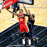 ORLANDO, FL - MARCH 03: Trae Young #11 of the Atlanta Hawks attempts a shot past Michael Carter-Williams #7 of the Orlando Magic during the second half at Amway Center on March 3, 2021 in Orlando, Florida. NOTE TO USER: User expressly acknowledges and agrees that, by downloading and or using this photograph, User is consenting to the terms and conditions of the Getty Images License Agreement. (Photo by Alex Menendez/Getty Images)*** Local Caption *** Trae Young; Michael Carter-Williams