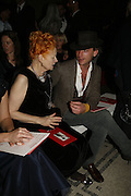 Vivienne Westwood and Andrew Steggall, Party to celebrate the Christian Lacroix Fashion in Motion fashion show and the opening of  	M/M Paris: Antigone Under Hypnosis part of  Paris Calling the UK-wide celebration of contemporary French culture. V. & A. London. 31 October 2006. -DO NOT ARCHIVE-© Copyright Photograph by Dafydd Jones 66 Stockwell Park Rd. London SW9 0DA Tel 020 7733 0108 www.dafjones.com