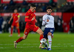 SWANSEA, WALES - Thursday, November 12, 2020: Wales' Harry Wilson is tackled by USA's Johnny Cardoso during an International Friendly match between Wales and the USA at the Liberty Stadium. (Pic by David Rawcliffe/Propaganda)