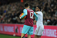 Carl Jenkinson of West Ham Utd (l) keeps the ball away from Neil Taylor of Swansea city. Barclays Premier league match, Swansea city v West Ham Utd at the Liberty Stadium in Swansea, South Wales  on Sunday 20th December 2015.<br /> pic by  Andrew Orchard, Andrew Orchard sports photography.