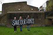 Young housing campaigners during the Reclaim Brixton Demonstration, an anti gentrification demonstration on 25th April 2015 in South London, United Kingdom. Cressingham Gardens is a council garden estate, located on the southern edge of Brockwell Park. It comprises of 306 dwellings and built to the design of Lambeth Borough Council architect Edward Hollamby in the early 1970s. In 2012, Lambeth Council proposed regeneration of the estate, a decision highly opposed by many residents. Since the announcement, the highly motivated campaign group Save Cressingham Gardens has been active.