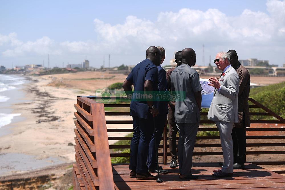 RETRANSMITTING CORRECTING LOCATION The Prince of Wales speaks to architect Kofi Adjaye (centre) during a visit to the Marine Drive Project in Accra, Ghana, on day four of his trip to west Africa with the Duchess of Cornwall..