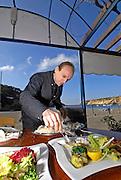 Expert waiter serving fish in a high class restaurant, Ibiza, Spain Photo by Nano Calvo - VWPics