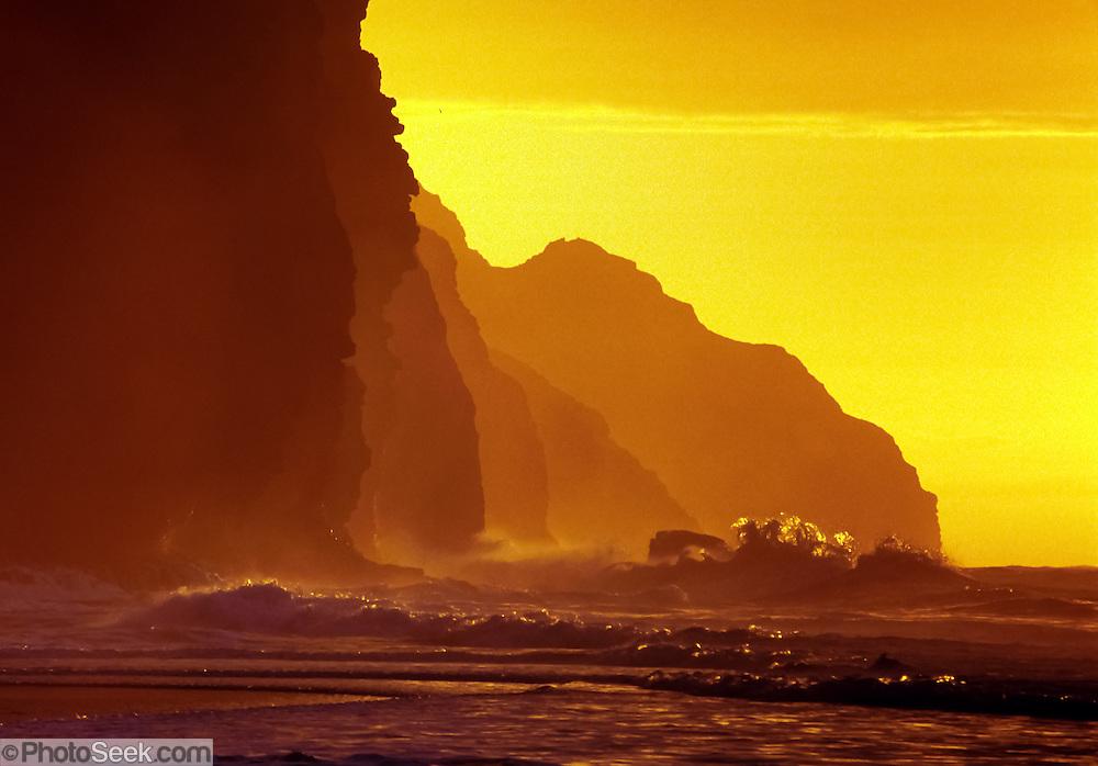 "Waves crash at sunset on Kalalau Beach, Na Pali Coast, Kauai, Hawaii, USA. Published in ""Light Travel: Photography on the Go"" by Tom Dempsey 2009, 2010."