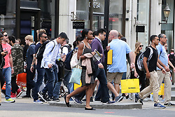 August 14, 2017 - London, London, United Kingdom - Image ©Licensed to i-Images Picture Agency. 14/08/2017. London, United Kingdom. Britain's inflation rate. .Britain's inflation rate has held steady at 2.6% in July. Tourists and locals shopping in Oxford Street on Monday 14 August 2017..Picture by Dinendra Haria / i-Images (Credit Image: © Dinendra Haria/i-Images via ZUMA Press)