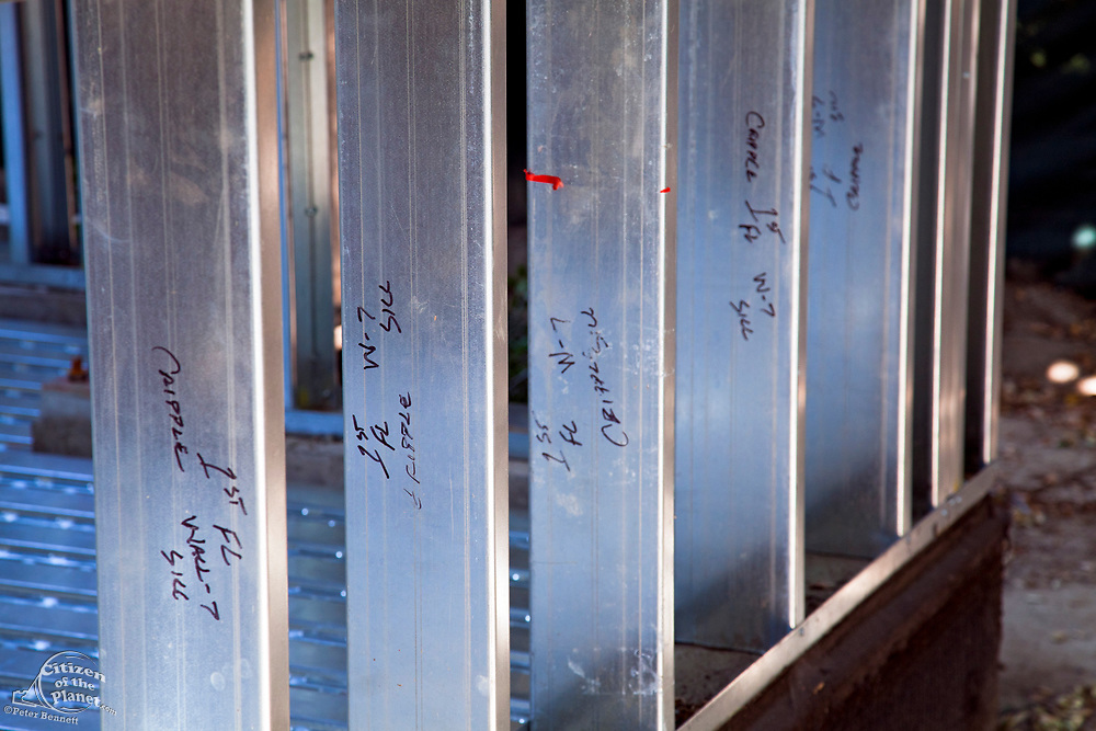 Instructions for assemply are written on the steel studs. Residential home construction site using steel for framing. Steel, while not a common material for residential framing, is 94% recyclable, has been milled locally for this project, and is a more sustainable choice than wood, which is typically used for residential building construction, Los Angeles, California, USA