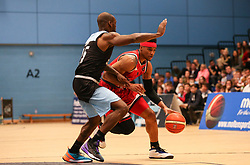 Justin Gray of Bristol Flyers dribbles the ball - Photo mandatory by-line: Arron Gent/JMP - 28/04/2019 - BASKETBALL - Surrey Sports Park - Guildford, England - Surrey Scorchers v Bristol Flyers - British Basketball League Championship