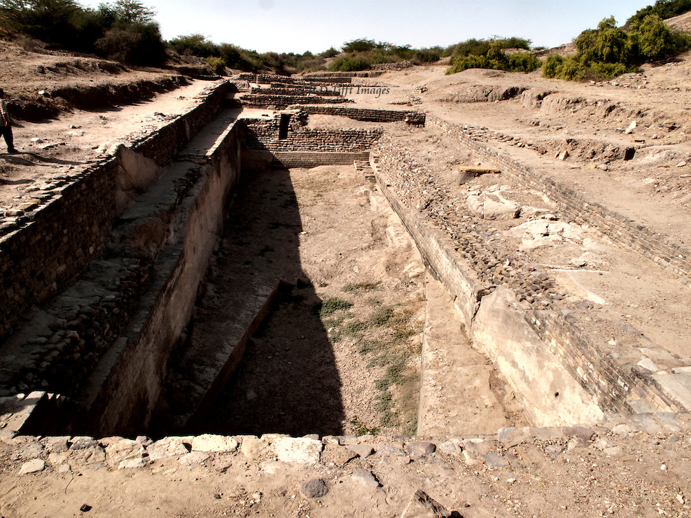 Longitudinal view of a vast ancient water tank at Dholavira showing how it was excavated down to the bedrock.