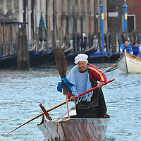 "VENICE, ITALY - JANUARY 06:  One of the participants dressed in costume races along the Grand Canal for the ""Befana"" Regatta on January 6, 2014 in Venice, Italy. In Italian folklore, Befana is an old woman who delivers gifts to children throughout Italy on the feast of the Epiphany on January 6 in a similar way to Saint Nicholas or Santa Claus.  (Photo by Marco Secchi/Getty Images)"